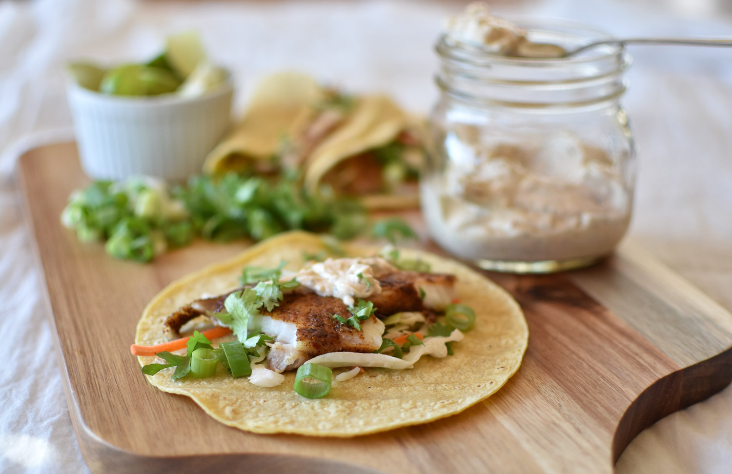 Fish tacos with chipotle crema with two spoons for Crema for fish tacos